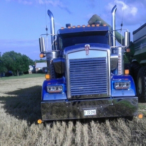 blue kenworth in fields