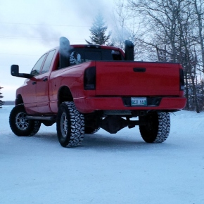 Red Dodge Cummins Diesel Truck with Stacks