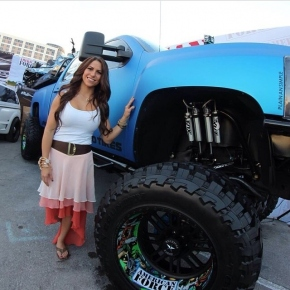 Lifted Duramax Diesel Truck with girl, wheels, tires, suspension, wrapped