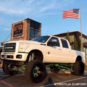 LIfted white ford powerstroke