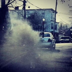 Car with a stack rolling coal