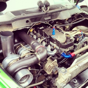 engine bay with hood stack